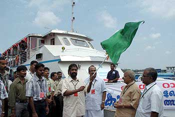 Honourable Member of Parliament Shri K Chandran Pillai, flagging off the boat on which a cartoon workshop organised, in connection with 'Yesudasan: Celebrating 50 Years of Responsible Cartooning', at Kochi, Kerala on May 19, 2005. Photo: Vipin Chandran, The Hindu.