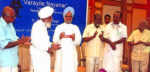 Honourable Prime Minster of India, Dr Manmohan Singh releases Yesudasan's 'Varayile Nayanar' at a function held at the Panchavadi, Prime Minister's Offical Residence, 7 Race Course Road, New Delhi on July 22, 2004. Former Chief Minister of Kerala Shri PK Vasudevan Nair, Shri Surjeet Singh, Union Minister for Power Shri PM Sayeed, Prof KV Thomas and Yesudasan next to him.